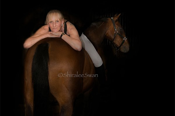 I took this photograph in a stable black background portrait