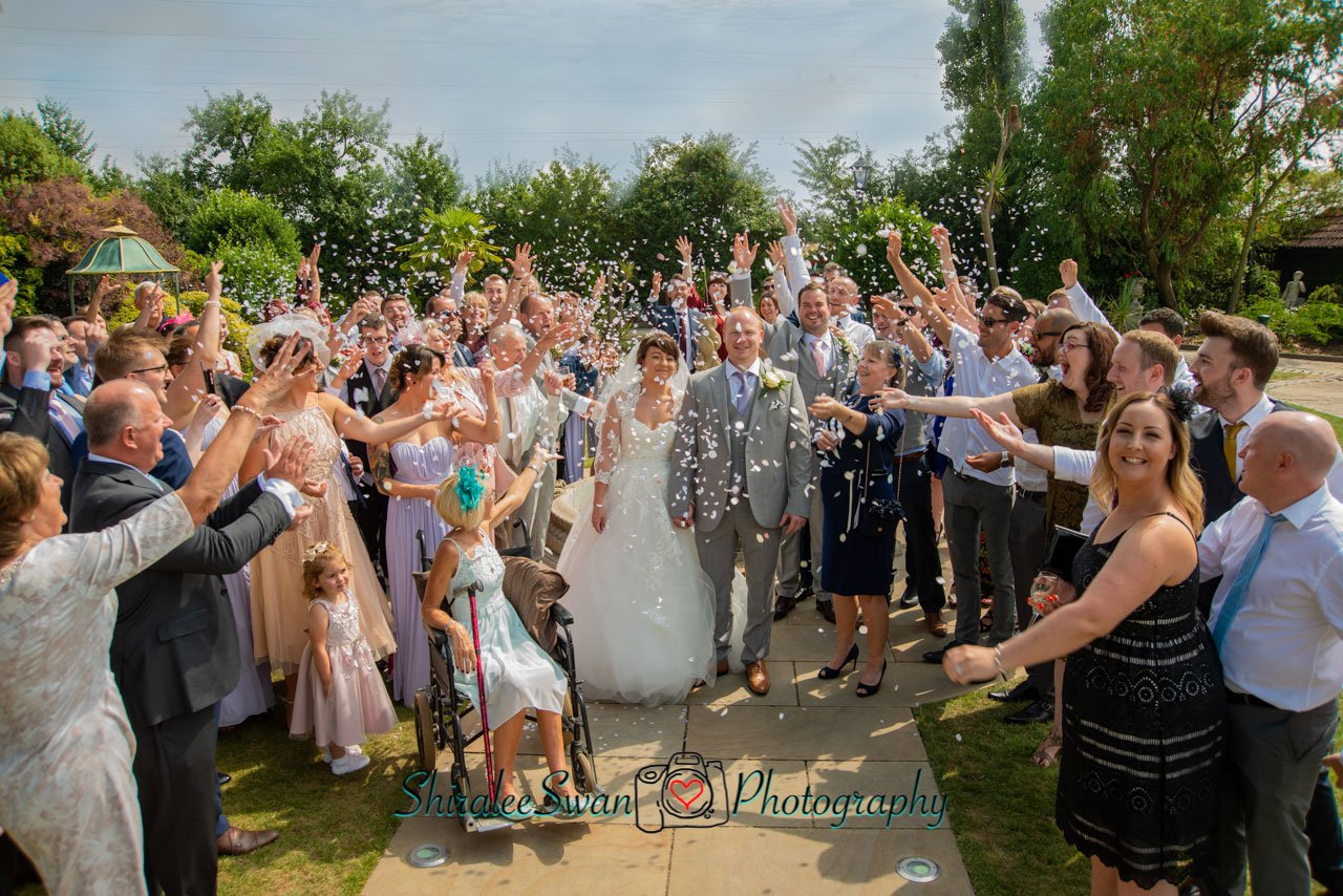 3-2-1- go... through the confetti near the fountain at Friern Manor
