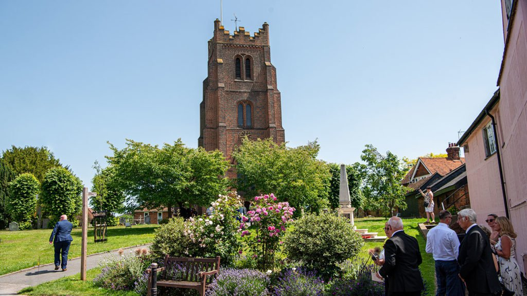 St Edmund and St Mary's Church stand in the centre of Ingatestone High Street surrounded by a well kept garden with trees and rose beds, the war memorial also stands in the churches garden